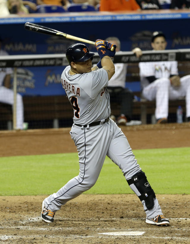 Detroit Tigers' Miguel Cabrera follows through on his second base hit against the Miami Marlins in the fifth inning of an interleague baseball game on Saturday, Sept. 28, 2013, in Miami. Torii Hunter reached second base on the single. (AP Photo/Alan Diaz)