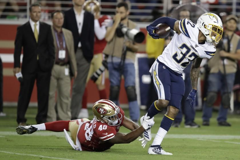 Los Angeles Chargers defensive back Nasir Adderley (32) intercepts a pass in front of San Francisco 49ers' Tyree Mayfield during the second half of an NFL preseason football game in Santa Clara, Calif., Thursday, Aug. 29, 2019. (AP Photo/Ben Margot)