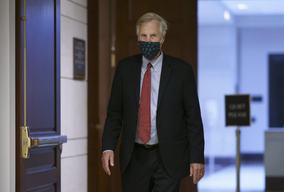 Sen. Angus King, I-Maine, walks through a corridor at the Capitol after the Senate failed to confirm President Donald Trump's controversial nominee to the Federal Reserve, Judy Shelton, at the Capitol in Washington, Tuesday, Nov. 17, 2020. (AP Photo/J. Scott Applewhite)