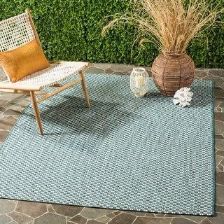 Safavieh Courtyard Judi Indoor Outdoor Rug (Amazon / Amazon)
