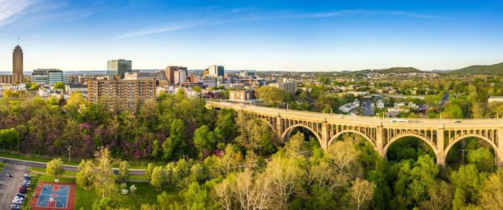 Aerial panorama of Allentown, Pennsylvania skyline and Albertus L. Meyers Bridge (aka Eighth Street Bridge) on late sunny afternoon . Allentown is Pennsylvania's third most populous city.