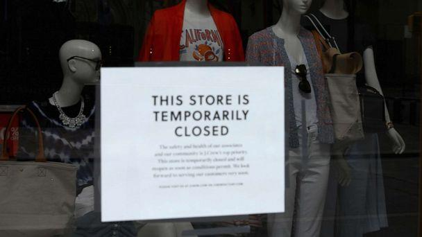 PHOTO: A sign is seen at the window of a closed store near Rockefeller Plaza on May 4, 2020 in New York City. (Angela Weiss/AFP via Getty Images)