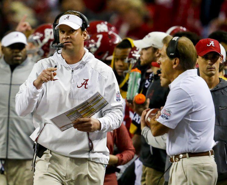 Alabama offensive coordinator Lane Kiffin makes a play call as head coach Nick Saban watches during the first half of the Peach Bowl NCAA college football game, Saturday, Dec. 31, 2016, in Atlanta. (AP Photo/Butch Dill)