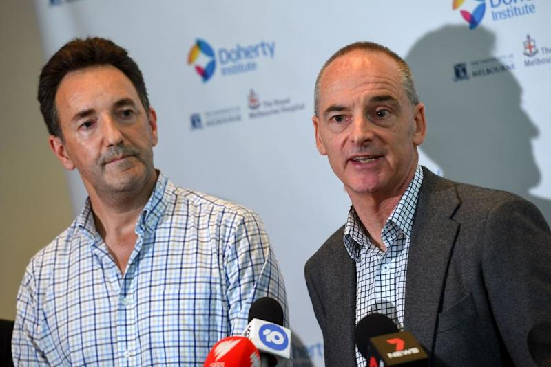 Dr Mike Catton (R) and Dr Julian Druce (L) speak at the Doherty Institute in Melbourne on January 29, 2020.