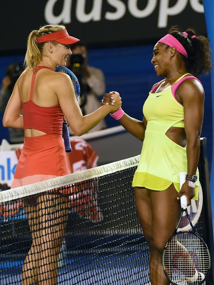 Serena Williams shakes hands with Maria Sharapova after the American's straight-sets victory (AFP Photo/Mal Fairclough)