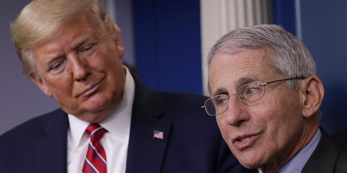 President Donald Trump and Dr. Anthony Fauci, the director of the National Institute of Allergy and Infectious Diseases, at a White House briefing on Friday.