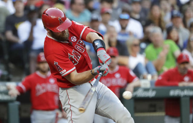 Los Angeles Angels' Kevan Smith singles in a run against the Seattle Mariners in the fourth inning of a baseball game Saturday, July 20, 2019, in Seattle. (AP Photo/Elaine Thompson)