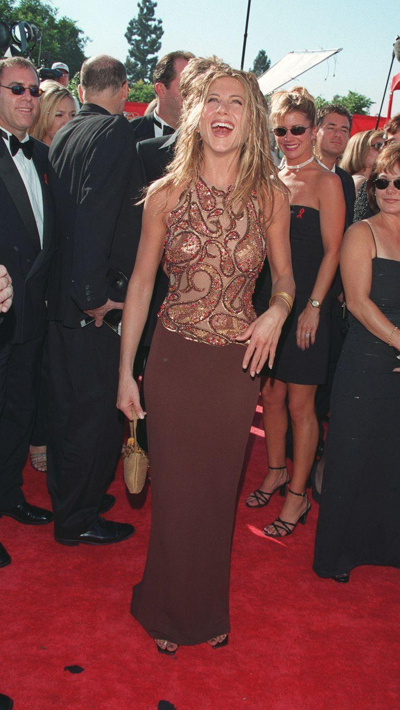 <p>For reasons completely unbeknownst to me, brown was a popular color in this time period, so here's Jennifer at the Emmy Awards wearing the hue and a coordinating sequined top. </p>