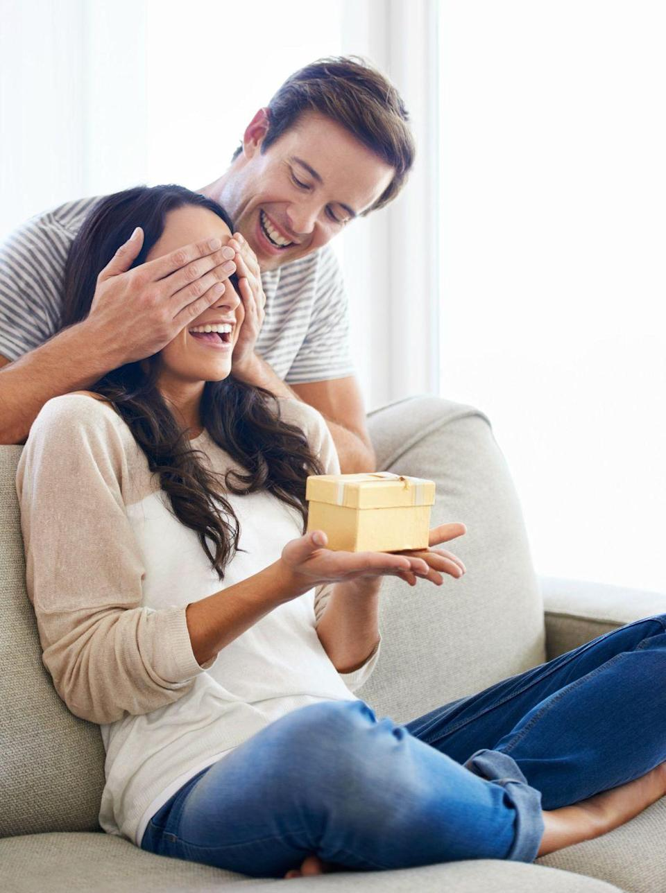 """<p>Though you may rule the household with shared Google calendars and group text messages, if your husband still makes an effort to surprise you with things he knows will brighten your day, then he still loves you lots, Weaver says. </p><p>""""This isn't about expensive gifts. Oftentimes it's something as simple as bringing home a favorite candy or carton of ice cream, or picking up tickets when you mentioned you wanted to see a certain movie,"""" she says. The point is that he's thinking of ways to keep your relationship <a href=""""https://www.womansday.com/relationships/dating-marriage/g3214/25-things-every-marriage-needs/"""" rel=""""nofollow noopener"""" target=""""_blank"""" data-ylk=""""slk:fresh and fun"""" class=""""link rapid-noclick-resp"""">fresh and fun</a>, and showing you that he still remembers the little things that make you smile. </p>"""