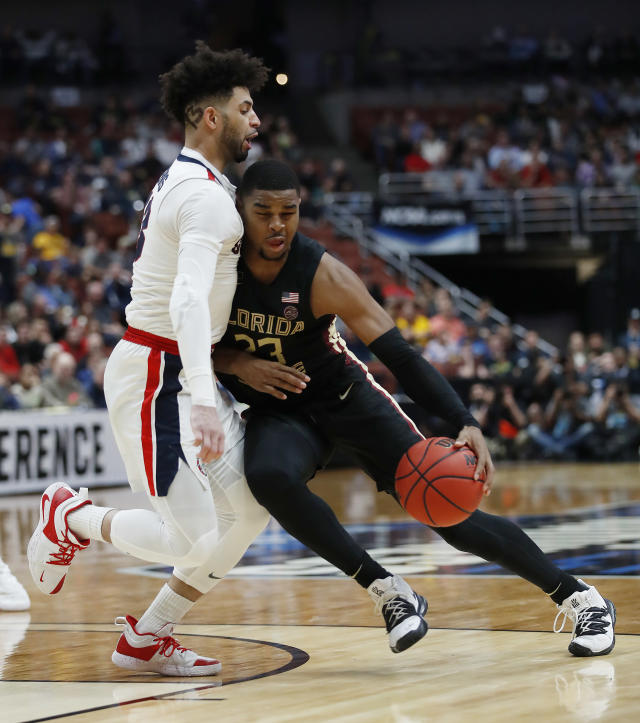 <p>M.J. Walker #23 of the Florida State Seminoles drives against Josh Perkins #13 of the Gonzaga Bulldogs during the 2019 NCAA Men's Basketball Tournament West Regional at Honda Center on March 28, 2019 in Anaheim, California. (Photo by Sean M. Haffey/Getty Images) </p>