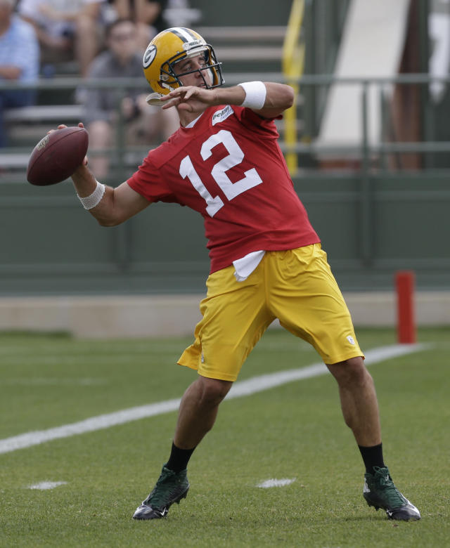 Green Bay Packers quarterback Aaron Rodgers throws a pass during NFL football minicamp Tuesday, June 17, 2014, in Green Bay, Wis. (AP Photo/Mike Roemer)