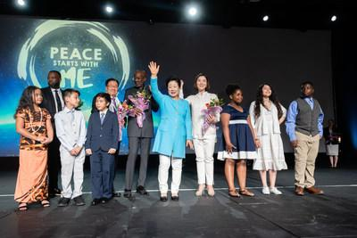 Dr. Hak Ja Han Moon, accompanied by Bishop Noel Jones, receiving flowers from local youth at the Peace Starts with Me Unity Festival in Las Vegas, NV