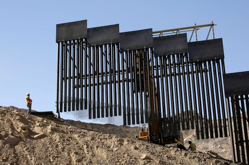 A construction crew works on a bollard-type private border wall, crowd-funded by We Build The Wall group at Sunland Park, New Mexico, as pictured from Ciudad Juarez, Mexico May 30, 2019. (Photo: Jose Luis Gonzalez/Reuters)
