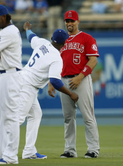 Albert Pujols (right) and Juan Uribe speak before the opener of the Freeway Series. (AP)