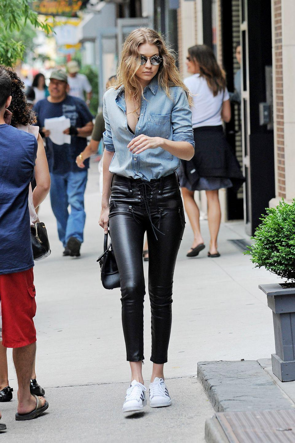 <p>Out in New York wearing a denim button-down shirt with lace-up leather pants by Unravel, plus Adidas sneakers. </p>