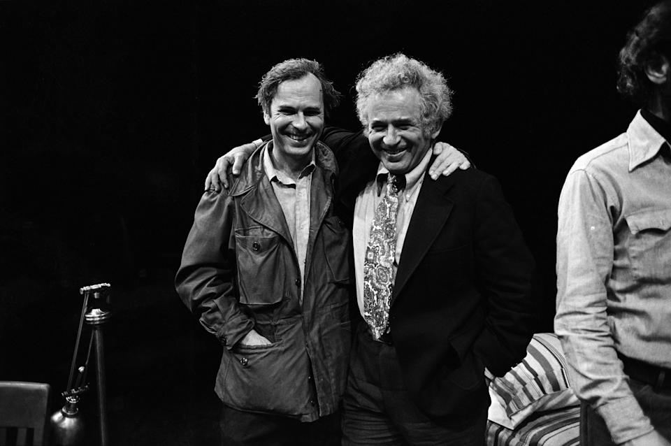 From left, American actor Rip Torn, author Norman Mailer (1923 - 2007), and playwright and theatre director Jack Gelber (1932 - 2003) (mostly obscured) on the set of Gelber's production of the play 'The Kitchen' (by Arnold Wesker) at the 81st Street Theatre, New York, New York, June 1966. Torn played the male lead in the production. (Photo by Susan Wood/Getty Images)