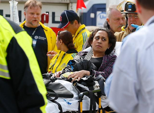 BOSTON, MA - APRIL 15: A woman is loaded into an ambulance after he was injured by one of two bombs exploded during the 117th Boston Marathon near Copley Square on April 15, 2013 in Boston, Massachusetts. Two people are confirmed dead and at least 23 injured after two explosions went off near the finish line to the marathon. (Photo by Jim Rogash/Getty Images)