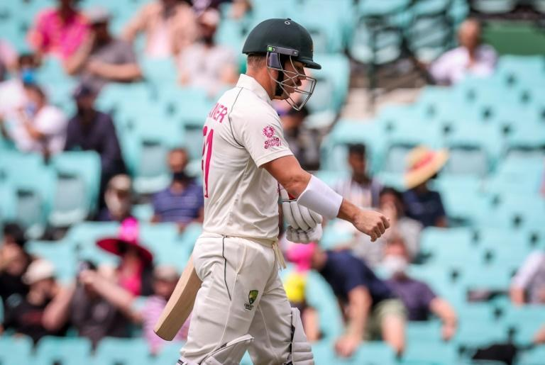 Australia's David Warner walks off after being dismissed for five by India's Mohammed Siraj on day one of the third Test at Sydney