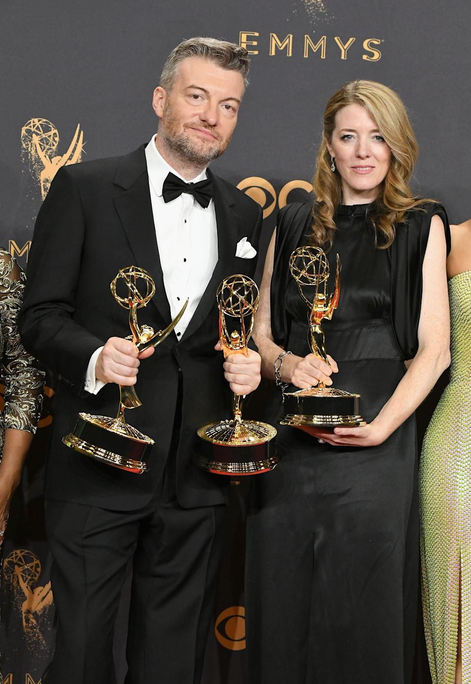 LOS ANGELES, CA - SEPTEMBER 17:  Producers Charlie Brooker (L) and Annabel Jones, winners of the award for Outstanding Television Movie for 'Black Mirror,' poses in the press room during the 69th Annual Primetime Emmy Awards at Microsoft Theater on September 17, 2017 in Los Angeles, California.  (Photo by Steve Granitz/WireImage)