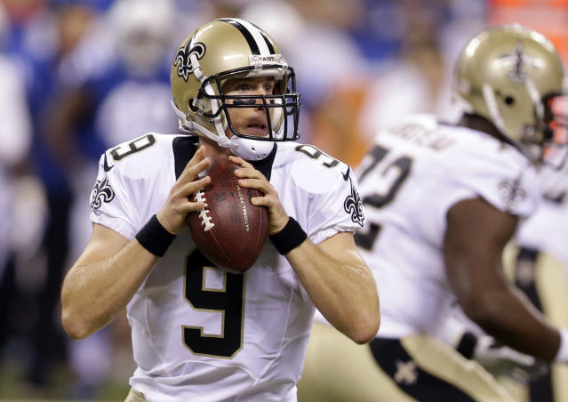 New Orleans Saints quarterback Drew Brees looks to throw against the Indianapolis Colts during the first half of an NFL preseason football game in Indianapolis, Saturday, Aug. 23, 2014. (AP Photo/Michael Conroy)