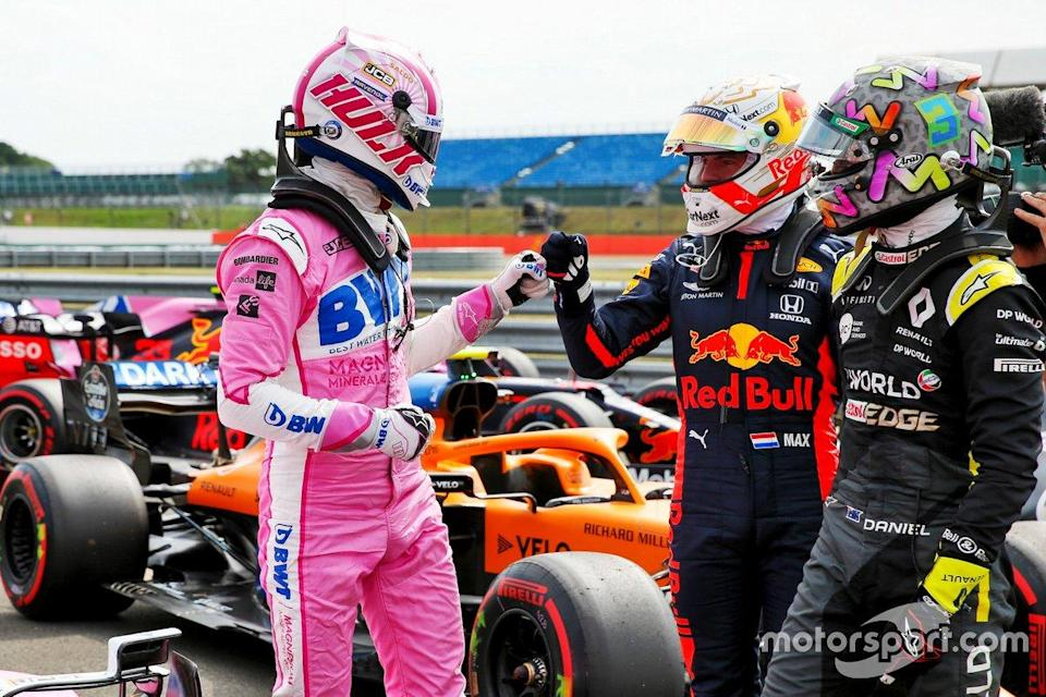 """Nico Hulkenberg, Racing Point celebrates in Parc Ferme with Max Verstappen, Red Bull Racing and Daniel Ricciardo, Renault F1<span class=""""copyright"""">FIA Pool</span>"""