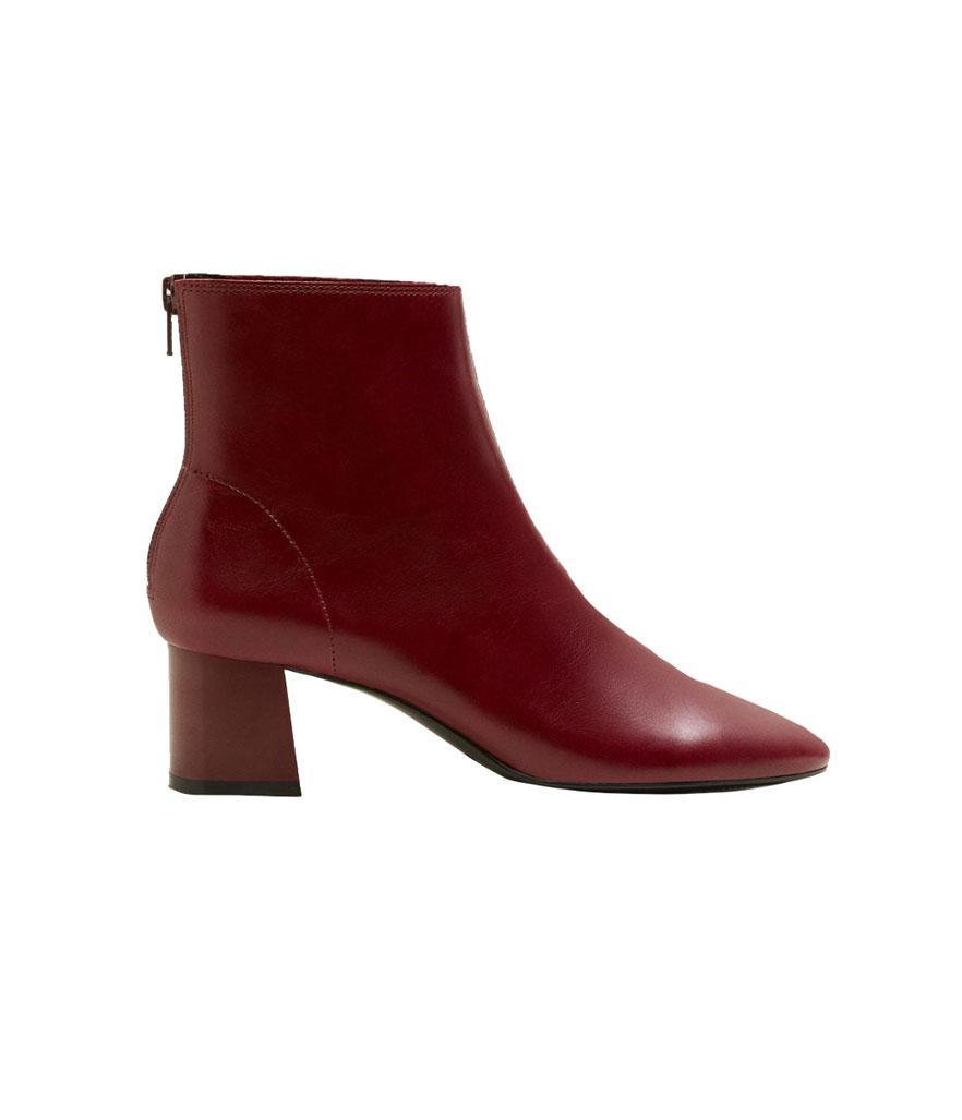 """<p>Don't let the bold cherry-red shade scare you away — these statement boots look fantastic with black trousers, midi skirts and dresses. <br><a href=""""https://fave.co/2qw7SNe"""" rel=""""nofollow noopener"""" target=""""_blank"""" data-ylk=""""slk:Shop it:"""" class=""""link rapid-noclick-resp"""">Shop it:</a> Heel Leather Ankle Boot, $80, <a href=""""https://fave.co/2qw7SNe"""" rel=""""nofollow noopener"""" target=""""_blank"""" data-ylk=""""slk:mango.com"""" class=""""link rapid-noclick-resp"""">mango.com</a> </p>"""