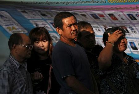 People queue up to vote at a polling station during the general election in Bangkok, Thailand, March 24, 2019. REUTERS/Athit Perawongmetha