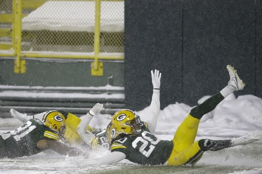 Green Bay Packers' Darnell Savage celebrates his interception with teammates during the first half of an NFL football game against the Tennessee Titans Sunday, Dec. 27, 2020, in Green Bay, Wis. (AP Photo/Mike Roemer)