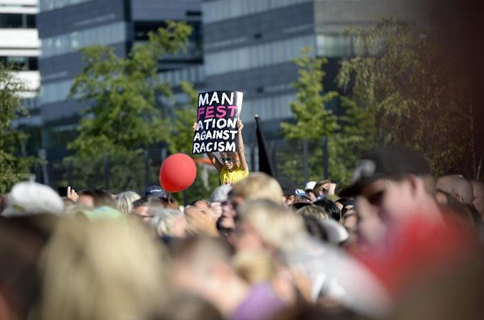 """Participants of a demonstration called, """"We have a Dream - Multiculturalism is not a nightmare"""" gather in Helsinki, Finland, on July 28, 2015 (AFP Photo/Vesa Moilanen)"""