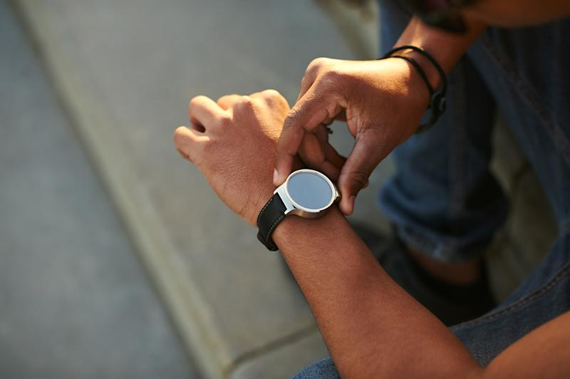 A user interacts with a smartwatch.