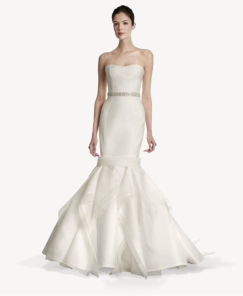 """This Carolina Herrera gown would be perfect because it shows off her best assets – her perfectly toned arms,"" says Jay Manuel, host of <a target=""_blank"" href=""http://shine.yahoo.com/the-thread/ "">""The Thread"" on Yahoo!</a>. ""This gown speaks to Jennifer's timeless all-American beauty. It's classic and unique; a dress you could see being handed down generation to generation. You can never go wrong in a Herrera.""<p><em>Follow Jay on Twitter <a target=""_blank"" href=""https://twitter.com/MrJayManuel"">@MrJayManuel</a>.</em> </p>"