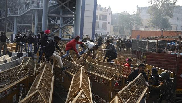 Farmers breached barricades placed inside the heart of Delhi and clashed with Police at several places. AP