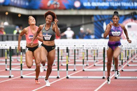 Jul 8, 2016; Eugene, OR, USA; Queen Harrison (left) and Brianna Rollins (middle) and Kristi Castlin (right) compete during the women's 100m hurdles finals in the 2016 U.S. Olympic track and field team trials at Hayward Field. Mandatory Credit: James Lang-USA TODAY Sports