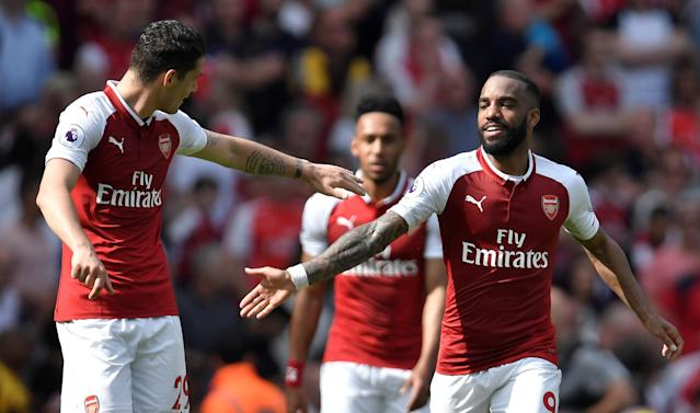 """Soccer Football - Premier League - Arsenal v West Ham United - Emirates Stadium, London, Britain - April 22, 2018 Arsenal's Alexandre Lacazette celebrates with Granit Xhaka after scoring their fourth goal REUTERS/Toby Melville EDITORIAL USE ONLY. No use with unauthorized audio, video, data, fixture lists, club/league logos or """"live"""" services. Online in-match use limited to 75 images, no video emulation. No use in betting, games or single club/league/player publications. Please contact your account representative for further details."""