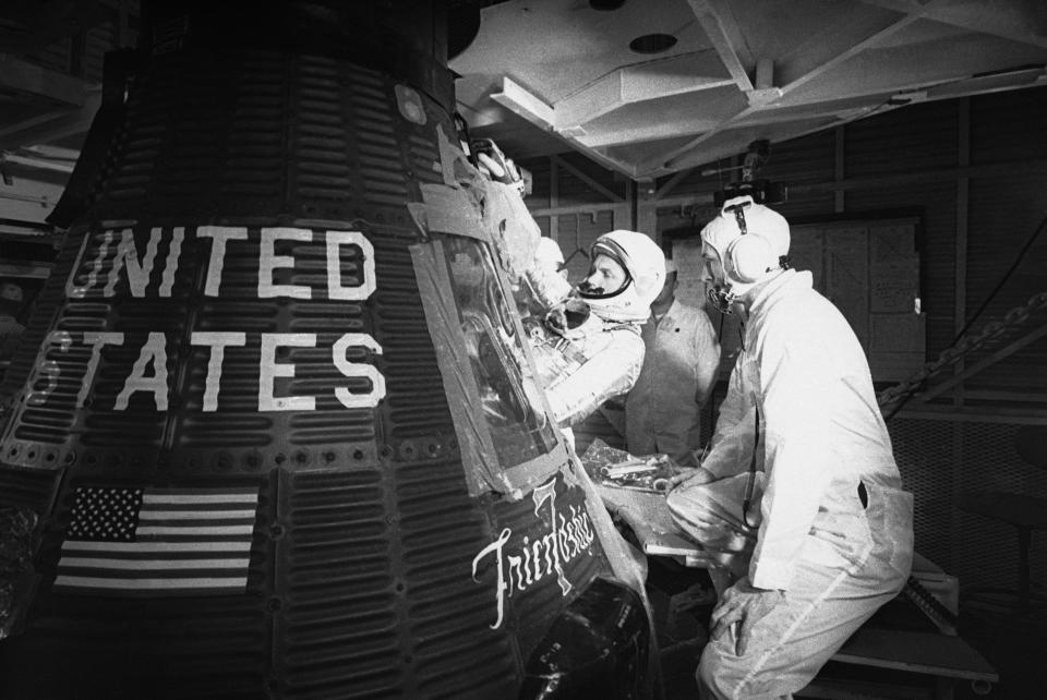 """FILE - In this Jan. 2, 1962, file photo, astronaut John Glenn climbs into the """"Friendship 7"""" Mercury capsule at Cape Canaveral, Fla. Glenn's birthplace and childhood hometown in Ohio are celebrating what would have been the history-making astronaut and U.S. senator's 100th birthday with a three-day festival from July 16 through July 18, 2021. (AP Photo/File)"""
