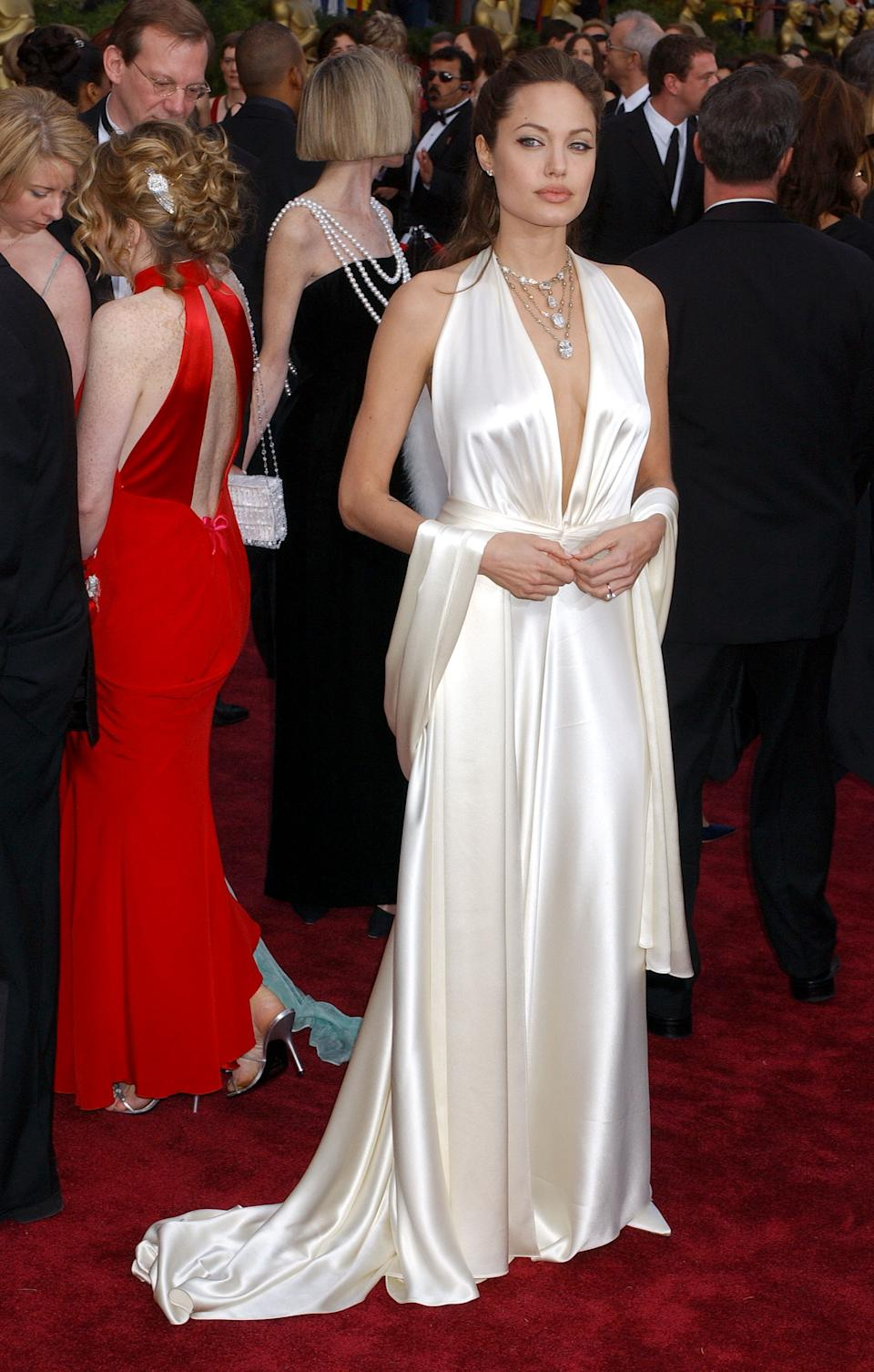<p>It's a difficult material and colour to pull off, but Jolie Jolie looked angelic in her plunging white satin gown by designer Marc Bouwer.</p>