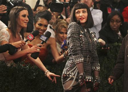 """Singer Madonna arrives at the Metropolitan Museum of Art Costume Institute Benefit celebrating the opening of """"PUNK: Chaos to Couture"""" in New York, in this May 6, 2013 file photo. REUTERS/Carlo Allegri/Files"""