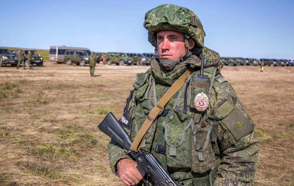 <em>A Russian soldier guards an area in the biggest military exercise since the Cold War (AP)</em>