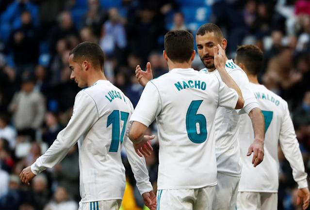 Soccer Football - La Liga Santander - Real Madrid vs Deportivo Alaves - Santiago Bernabeu, Madrid, Spain - February 24, 2018 Real Madrid's Karim Benzema celebrates scoring their fourth goal with Nacho REUTERS/Juan Medina