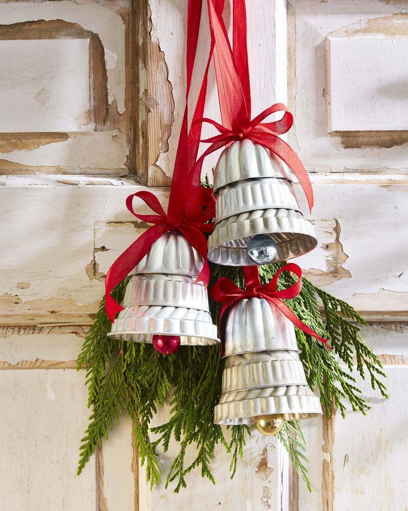 """<p>Hang these pretty ornaments on your front door or drape on your tree.</p><p><strong>To make: </strong>Stack mini molds and Bundt pans to form bell shapes; affix together using epoxy. Hot-glue small ornaments to the bottom to create the clappers. Glue ribbon loops and a bow to the top for hanging. Add a swag of greenery, if desired.</p><p><a class=""""link rapid-noclick-resp"""" href=""""https://www.amazon.com/Bezall-Aluminum-Cupcake-Cookie-Pudding/dp/B00T5K0GGO/ref=sr_1_12?tag=syn-yahoo-20&ascsubtag=%5Bartid%7C10050.g.1070%5Bsrc%7Cyahoo-us"""" rel=""""nofollow noopener"""" target=""""_blank"""" data-ylk=""""slk:SHOP MOLDS"""">SHOP MOLDS</a></p>"""