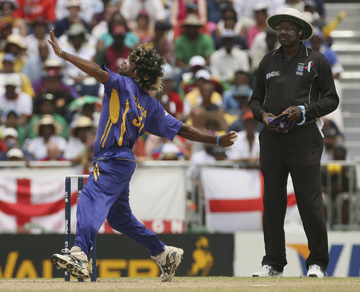 BRIDGETOWN, BARBADOS - APRIL 28:  Lasith Malinga of Sri Lanka bowls with umpire Steve Bucknor looking on during the ICC Cricket World Cup Final between Australia and Sri Lanka at the Kensington Oval on April 28, 2007 in Bridgetown, Barbados.  (Photo by Hamish Blair/Getty Images)