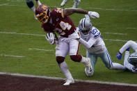 Washington Football Team running back Antonio Gibson (24) scores a touchdown against Dallas Cowboys cornerback Trevon Diggs (27) in the first half of an NFL football game, Sunday, Oct. 25, 2020, in Landover, Md. (AP Photo/Susan Walsh)