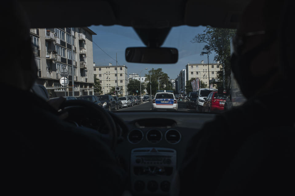 Police officers patrol in a car in the Paris suburb of Sarcelles, Tuesday, June, 15, 2021. In the run-up to France's presidential elections in 2022, crime and policing are again becoming hot-button issues. Some political opponents of President Emmanuel Macron argue that France is becoming an increasingly violent country. (AP Photo/Lewis Joly)