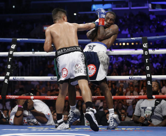 Mikey Garcia, left, punches Robert Easter Jr. during their WBC and IBF lightweight title bout in Los Angeles, Saturday, July 28, 2018. (AP Photo/Alex Gallardo)