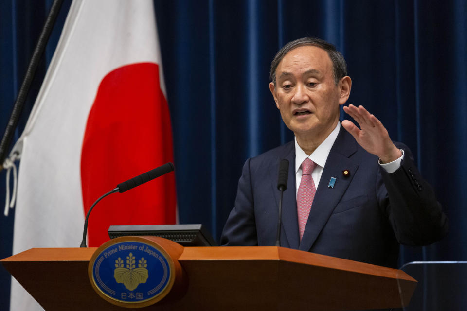 Japanese Prime Minister Yoshihide Suga speaks during a press conference at the prime minister's official residence on Friday, May 14, 2021, in Tokyo. Suga announced that the current coronavirus state of emergency covering Tokyo, Osaka and a number of other areas, will be extended to the prefectures of Hokkaido, Okayama and Hiroshima from Sunday as Japan battles a fourth wave of coronavirus. (Yuichi Yamazaki/Pool Photo via AP)
