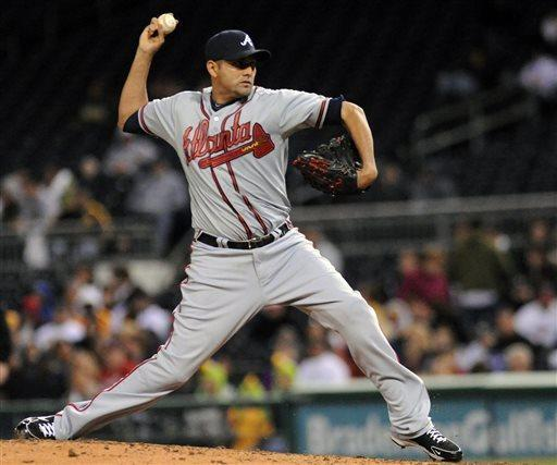 Atlanta Braves relief pitcher Luis Ayala delivers in the sixth inning against the Pittsburgh Pirates during a baseball game at PNC Park, Friday, April 19, 2013, in Pittsburgh. (AP Photo/John Heller)