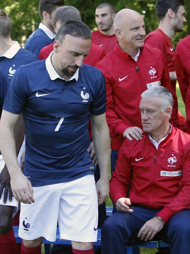 France's forward Franck Ribery, left, walks out as France's assistant coach Guy Stephan, right, holds the shoulder of head coach Didier Deschamps, bottom right, after the team picture at the French national football team's training base, in Clairefontaine, outside Paris, Friday, June 6, 2014 as part of France's national football team's preparation for the upcoming FIFA 2014 World Cup in Brazil. (AP Photo/Francois Mori)