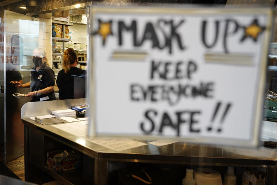 Waitress Kim Iannacone, left, and manager Yllka Murati gather food orders at the Penrose Diner, Tuesday, Nov. 17, 2020, in south Philadelphia. Philadelphia plans to prohibit indoor dining at restaurants, shutter casinos, gyms, museums and libraries, pause in-person instruction at colleges and high schools, and reduce occupancy at stores and religious institutions, the health commissioner, Dr. Thomas Farley, said at a news conference Monday as the city battles a resurgence of the coronavirus. (AP Photo/Matt Slocum)