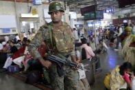 An Indian police officer keeps guard at Chhatrapati Shivaji Terminus railway station in Mumbai, India, Thursday, Feb. 28, 2019. Pakistan's prime minister pledged on Thursday his country would release a captured Indian jetfighter pilot the following day, a move that could help defuse the most-serious confrontation in two decades between the nuclear-armed neighbors over the disputed region of Kashmir. An Indian government official, speaking on condition of anonymity as he was not authorized to speak publicly, warned that even if the pilot is returned home, New Delhi would not hesitate to strike its neighbor first if it feared a similar militant attack was looming. (AP Photo/Rajanish Kakade)