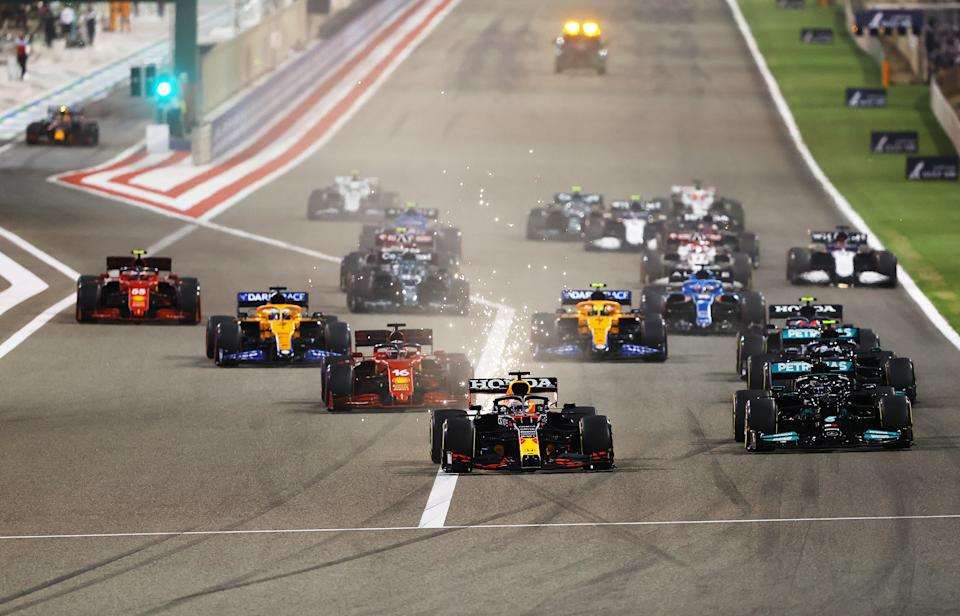 BAHRAIN, BAHRAIN - MARCH 28: Max Verstappen of the Netherlands driving the (33) Red Bull Racing RB16B Honda leads the rest of the field at the start of the race into the first corner during the F1 Grand Prix of Bahrain at Bahrain International Circuit on March 28, 2021 in Bahrain, Bahrain. (Photo by Bryn Lennon/Getty Images)